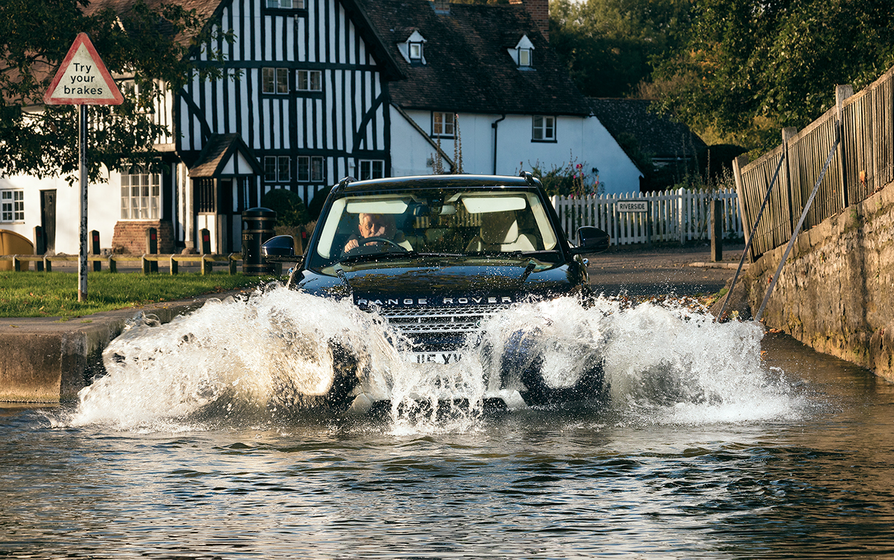 Range Rover Evoque splashing through Eynsford ford by automotive car photographer Darren Woolway